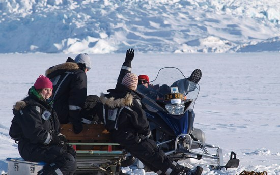Kristen Peck on a snowmobile in Svalbard